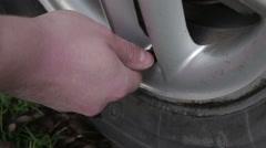 Man unscrew nipple on wheel Stock Footage