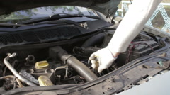 Check the engine oil level  Stock Footage