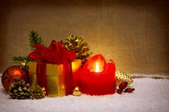 Advent candle and christmas decoration. - stock photo