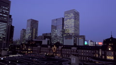 Night View of Tokyo Station with Office Buildings in Nihonbashi Stock Footage