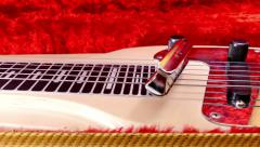 Lap steel guitar with slide bar rocking on strings. Stock Footage