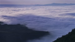 Dense fog and shadows of clouds moving over the valley-timelapse Stock Footage