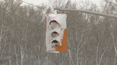 LED energy saving traffic lights cold dangerous and covered in snow during storm Stock Footage