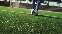 A soccer player does some fancy footwork with a soccer ball Stock Footage