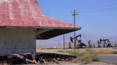 Oil fields and derricks near Bakersfield, California. Stock Footage