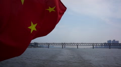 Chinese national flag flying on sailing ship Stock Footage