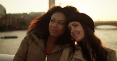 Girlfriends watch sunset over London. Shot on RED Epic. - stock footage