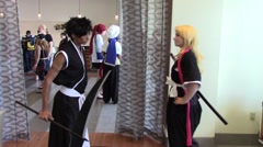 Two anime cosplay samurais fighting - comicon - Long Version Stock Footage