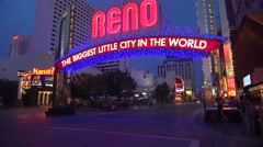 The Reno arch is illuminated at night. Stock Footage