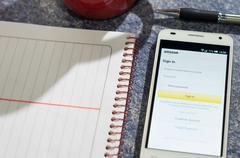 White smartphone lying on table with Amazon - stock photo