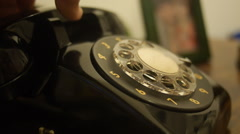 Close-up hand dialing a number in old telephone Stock Footage