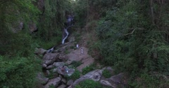 floating over people at Huay Kaew waterfall - stock footage