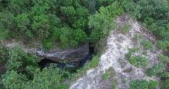 high birds eye over huay kaew waterfalls - stock footage