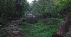 moving past the trees to the Huay Kaew waterfall - stock footage