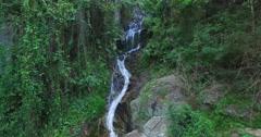 aerial flight towards huay kaew waterfalls - stock footage