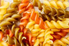 Uncook fusilli background. - stock photo