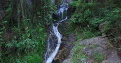 aerial flight away from huay kaew waterfalls - stock footage