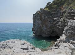 Panoramic view of the small cove and grotto in rocks. Stock Photos
