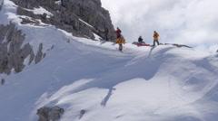 Skier Riding Down a steep mountain - stock footage