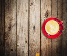 red cup and latte coffee on wood table with space - stock photo