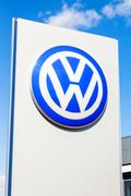 Official dealership sign of Volkswagen against blue sky Stock Photos