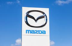 Official dealership sign of Mazda - stock photo