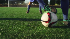 A soccer player does some fancy footwork while going up against other players Stock Footage