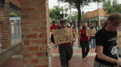 A group of protesters downtown Stock Footage