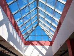 Bottom view on the triangular glass roof - stock photo