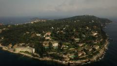 Saint Jean Cap Ferrat Aerial backwards over bay with neighborhood peninsula view - stock footage
