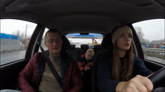 Family of three people traveling around the city in a car. Mother, father, son Stock Footage