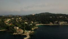 Saint Jean Cap Ferrat Aerial over bay panning right with peninsula view Stock Footage