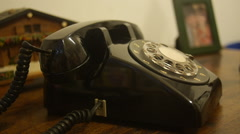 Hands answers picks-up and puts down old telephone Stock Footage