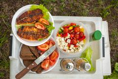 Various meals at picnic on the table Stock Photos