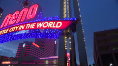 The Reno arch is illuminated at night. - stock footage