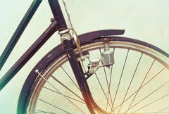 beautiful Old rusty bicycle retro with awesome effect colors on grunge grey - stock photo
