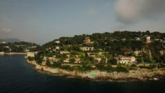 Saint Jean Cap Ferrat Aerial over bay panning left with peninsula view Stock Footage