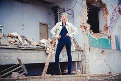 Stock Photo of Blonde in the coat on the ruins of the house, beauty