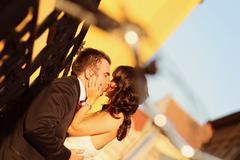 Beautiful bride and groom celebrating their wedding day in city Stock Photos