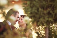 Beautiful bride and groom celebrating their wedding day in city - stock photo