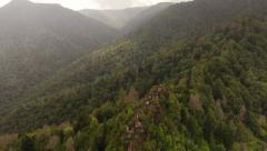 Smoky Mountains Aerial low backwards over Chimney Tops summit - stock footage