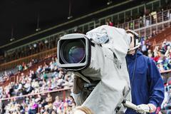 Cameraman opposite the racecourse grandstand Stock Photos