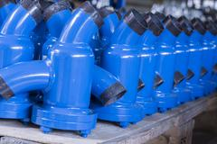 Fittings and ball valve with selective focus on thread fittings. Stock Photos