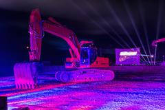 Laser show with excavators - stock photo