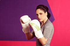 Stock Photo of Portrait of a female boxer with gloves