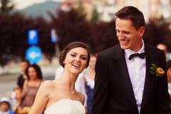 Beautiful bride and groom posing on wedding day Stock Photos