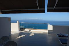 Shadows on hotel terrace and Gomera Island in the ocean. Stock Photos