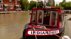 Static Shot of Narrowboat Moored Opposite Pub - stock footage