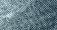 Floor of swimming poll covered with small gray-blue tiles under clear water a - stock photo