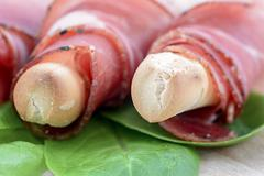 Breadstick with speck Stock Photos